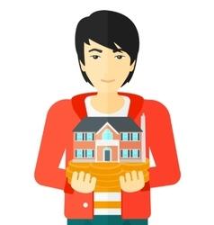 Man holding house model vector image