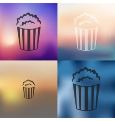 Popcorn icon on blurred background vector