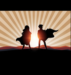 silhouette man and women superhero with sunlight vector image