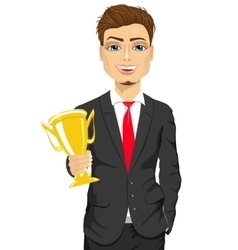 business man winner holding a gold cup trophy vector image