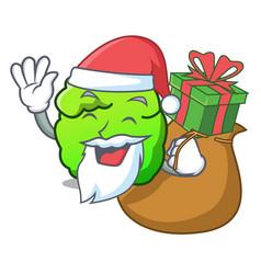 Santa with gift shrub mascot cartoon style vector
