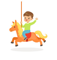 cute little boy riding on the carousel horse kid vector image