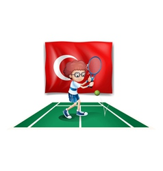 A boy playing tennis in front of the flag of vector image