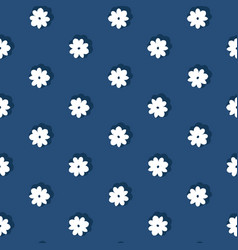 Tiny hand drawn folklore daisies on blue vector