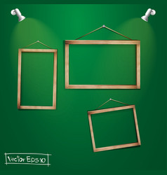 Wood frames on the green wall vector image
