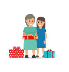 mother and daughter share christmas presents vector image vector image