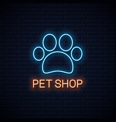 Pet shop neon neon pet paw on wall background vector