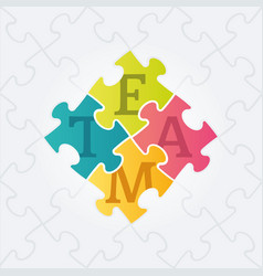 four jigsaw puzzle pieces with team word vector image