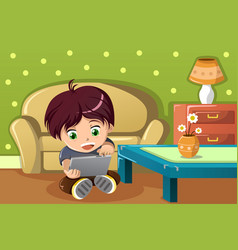 Boy using a tablet pc vector