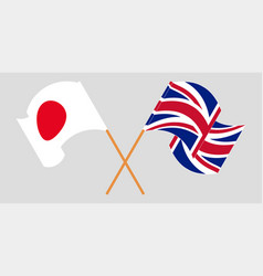 Crossed and waving flags uk and japan vector