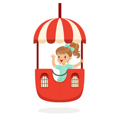 cute little girl riding a colorful carousel kid vector image