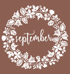 hand drawn september sign with wreath on brown vector image