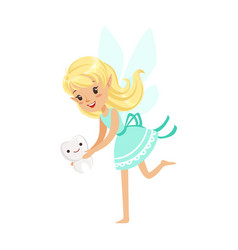 Beautiful sweet blonde tooth fairy girl holding vector