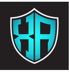Xa logo monogram with shield shape isolated blue vector