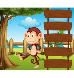 A monkey beside a wooden signage vector