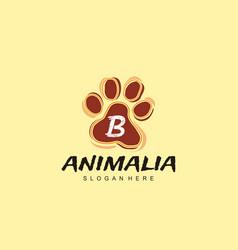 B letter in paw shape design pet logo design dog vector