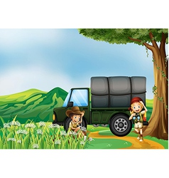A girl and a boy beside the green truck vector