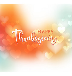 Hand drawn happy thanksgiving lettering on blurred vector