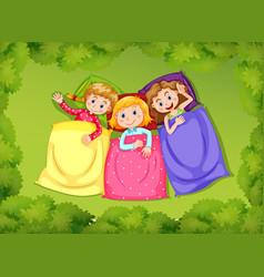 Three girls sleeping on green grass vector