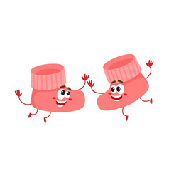 pair of funny baby booty sock characters playing vector image