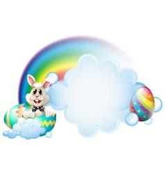 A cracked egg with a bunny near the rainbow vector image