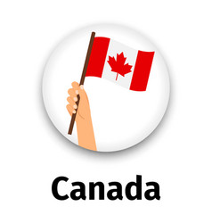 Canada flag in hand round icon vector
