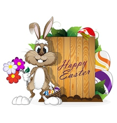 Easter bunny with egg basket vector