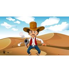 A cowboy smoking with a gun at the desert vector image