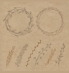 set of decorative doodle wreaths made of branches vector image