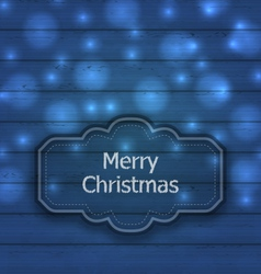 Christmas label on wooden texture with light - vector image vector image