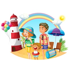A family at the beach with a lighthouse vector image