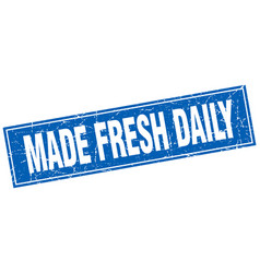 Made fresh daily blue square grunge stamp on white vector