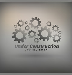 Gray background with gears and under construction vector