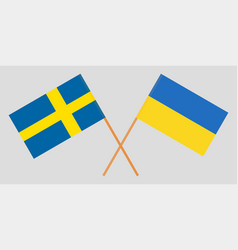 crossed flags ukraine and sweden vector image