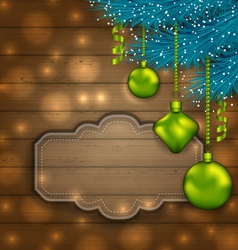 New Year label with balls and fir twigs on wooden vector image