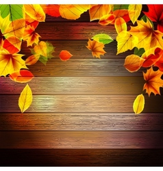 Yellow wet autumn leaves on the background EPS10 vector image