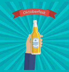 hand holding bottle beer vector image vector image