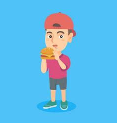little caucasian boy eating a hamburger vector image