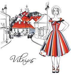 Fashionable girl in old town of vilnius lithuania vector