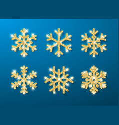 shining gold glitter glowing snowflakes on blue vector image