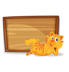 A tiger beside an empty wooden signage vector image vector image