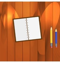 Notepad and Pencils on the Table vector image