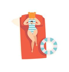 Beautiful young woman sunbathing on the beach top vector