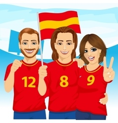 Three excited Spanish soccer fans in stadium vector
