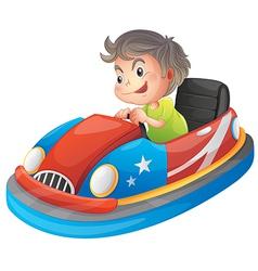 A young boy riding a bumper car vector image
