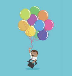A black businessman flying with balloons business vector
