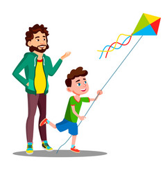 happy father and child son launch a kite vector image