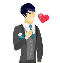 Young asian groom holding hand on his chest vector