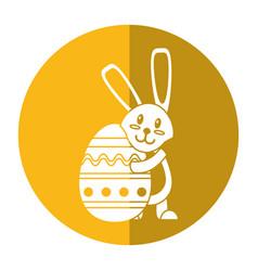 easter rabbit hugging egg shadow vector image vector image