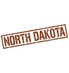 North dakota brown square stamp vector